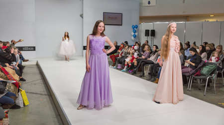 KYIV, UKRAINE - FEBRUARY 09, 2018: Fashion young girls teenager beautiful models at Kyiv Fashion 2018 in KyivExpoPlaza exhibition center. It is the main b2b event of Ukrainian fashion industry.