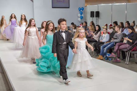 KYIV, UKRAINE - FEBRUARY 09, 2018: Fashion young little boy and girls beautiful models at Kyiv Fashion 2018 in KyivExpoPlaza exhibition center. It is the main b2b event of Ukrainian fashion industry. Éditoriale