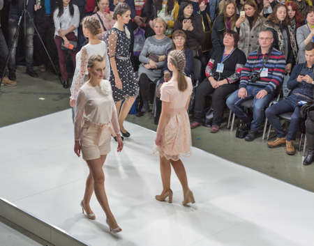 KYIV, UKRAINE - FEBRUARY 07, 2018: Fashion young beautiful models catwalk at Kyiv Fashion 2018 in KyivExpoPlaza exhibition center. It is the main b2b event of Ukrainian fashion industry. Éditoriale