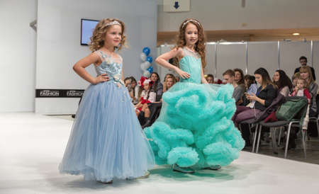 KYIV, UKRAINE - FEBRUARY 09, 2018: Fashion young little girls beautiful models at Kyiv Fashion 2018 in KyivExpoPlaza exhibition center. It is the main b2b event of Ukrainian fashion industry.