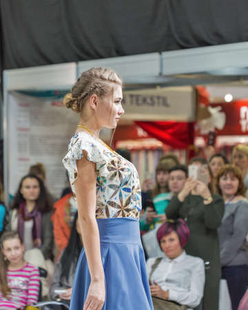 KYIV, UKRAINE - FEBRUARY 08, 2018: Fashion young beautiful model at show of Kyiv Fashion 2018 in KyivExpoPlaza exhibition center. It is the main b2b event of Ukrainian fashion industry. Éditoriale