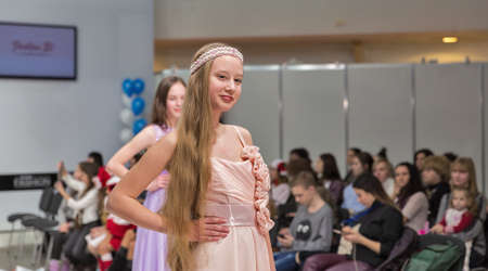 KYIV, UKRAINE - FEBRUARY 09, 2018: Fashion young girls teenager beautiful models at Kyiv Fashion 2018 in KyivExpoPlaza exhibition center. It is the main b2b event of Ukrainian fashion industry.