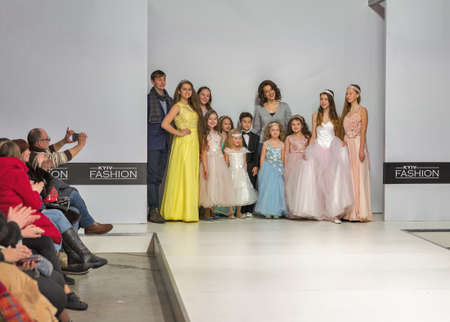 KYIV, UKRAINE - FEBRUARY 09, 2018: Children beautiful models with fashion designer at Kyiv Fashion 2018 in KyivExpoPlaza exhibition center. It is the main b2b event of Ukrainian fashion industry.