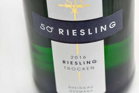 KIEV, UKRAINE - NOVEMBER 11, 2018: German 50 Riesling bottle label closeup against white background. Rheingau region is one of the most important wine growing regions in Germany.
