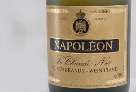KIEV, UKRAINE - FEBRUARY 17, 2019: French pure grape V.S.O.P. brandy Napoleon old bottle label closeup against white background.