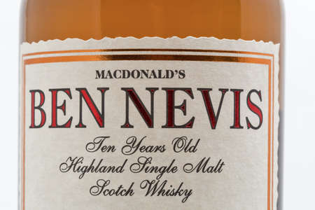 KYIV, UKRAINE - SEPTEMBER 21, 2019: Ben Nevis ten years old Highland Single Malt Scotch Whisky bottle label closeup against white background. Ben Nevis is the highest mountain in the British Isles.