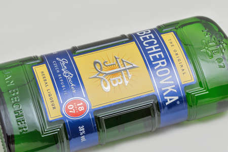 KYIV, UKRAINE - DECEMBER 31, 2019: Czech herbal bitter Becherovka bottle closeup against white background. It is produced in Karlovy Vary, Czech Republic by the Jan Becher company. Éditoriale