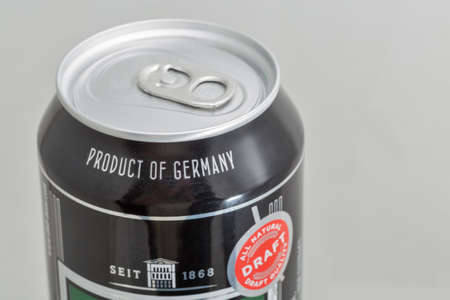 KYIV, UKRAINE - DECEMBER 31, 2019: DAB dark German beer can closeup against white background. Dortmunder Actien Brauerei is a German brewery in the city of Dortmund, founded in 1868.