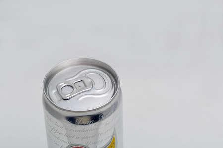 KYIV, UKRAINE - DECEMBER 31, 2019: Schweppes Bitter Lemon Original can closeup against white background. Schweppes is a Swiss beverage brand that is sold around the world.