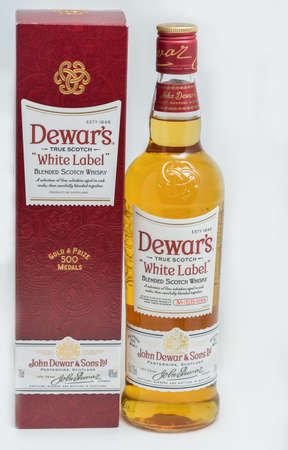 KIEV, UKRAINE - NOVEMBER 11, 2018: Dewar's White Label blended Scotch Whisky bottle and box closeup against white. Dewar's whiskies have won more than 400 awards and medals in over 20 countries.