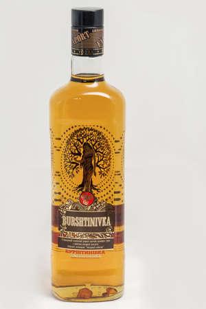 KIEV, UKRAINE - NOVEMBER 11, 2018: Burshtinivka Ukrainian vodka with amber and succinic acid bottle closeup against white background.