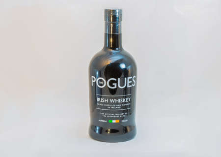 KIEV, UKRAINE - FEBRUARY 17, 2019: The Pogues blended Irish Whiskey triple distilled and matured bottle closeup. It is the official whiskey of legendary band The Pogues. Éditoriale