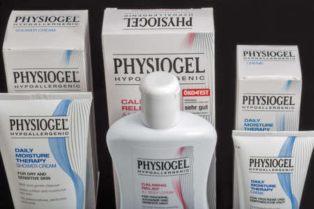 KYIV, UKRAINE - MARCH 28, 2020: Physiogel hypoallergenic dermo cosmetics closeup against black background. Physiogel brand is a British manufacturer of skin care products.
