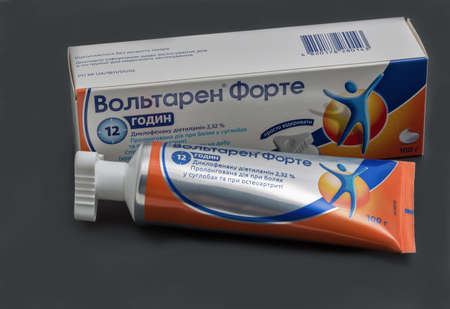 KYIV, UKRAINE - DECEMBER 31, 2019: Voltaren Forte tube of emulgel closeup against black background. It is a topical anti-inflammatory gel, contains diclofenac and is used to relieve pain and swelling.