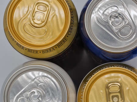 different closed beer drinking cans closeup view from above