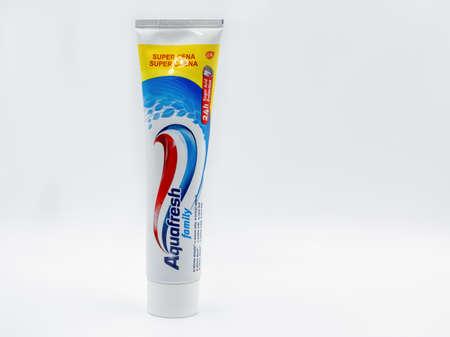 KYIV, UKRAINE - NOVEMBER 14, 2020: Aquafresh family fluoride toothpaste tube closeup against white. GSK consumer healthcare sells Aquafresh, Maclean's and Sensodyne toothpastes. Editorial
