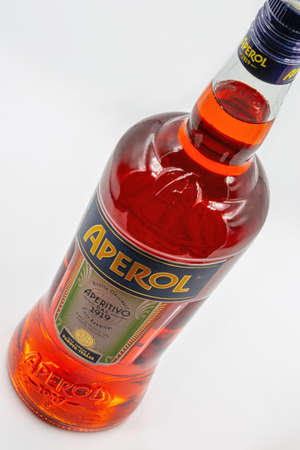 KYIV, UKRAINE - DECEMBER 16, 2020: Studio shoot of Aperol Aperitivo Liqueur bottle closeup against white. Famous Italian aperitif produced by DCM Spa, Italy.
