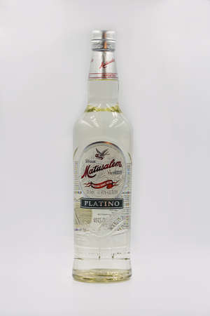 KYIV, UKRAINE - DECEMBER 16, 2020: Studio shoot of Matusalem Platino white Cuban rum bottle closeup against white.
