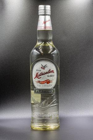 KYIV, UKRAINE - DECEMBER 16, 2020: Studio shoot of Matusalem Platino white Cuban rum bottle closeup against black. Editoriali