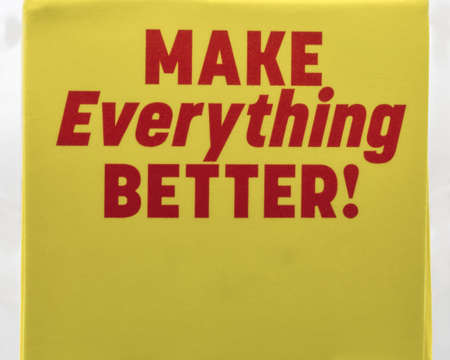 Red positive sign Make Everything Better closeup on yellow background