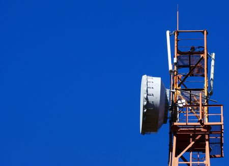 Cellular communications tower on a clear day the blue sky