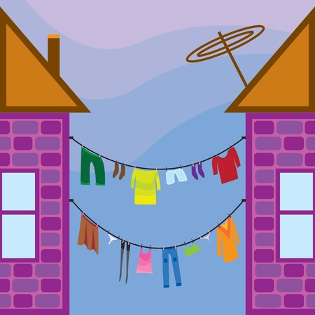 Washed clothes on a line between the houses Vector