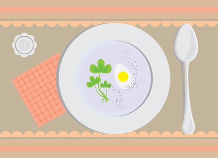 bowl of soup with a spoon on the tablecloth