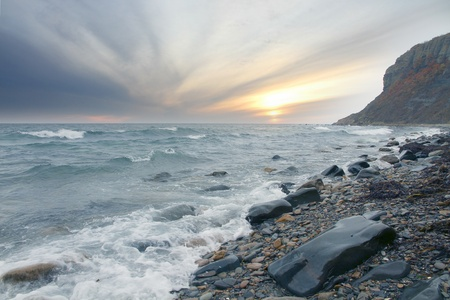coast at sunset in front of bad weather