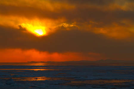 sunset on the frozen sea photo