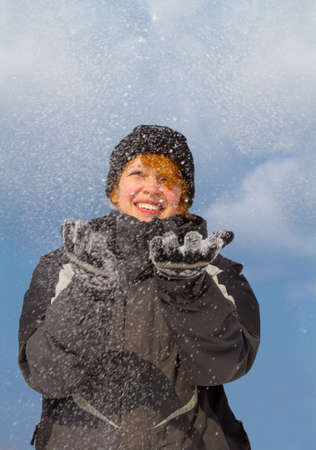 cute girl catches the snow in his hands Stock Photo