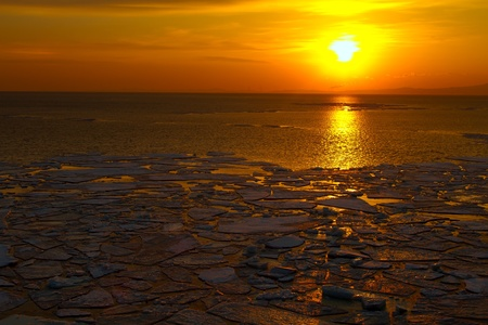 Sunset over the sea from the ice floes photo