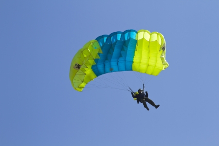 NOVONEZHINO, RUSSIA - MARCH 31, 2012: Airshow devoted to 14 anniversary of the Primorsky Aeroclub, Novonezhino, Russia, march 31, 2012. The program - skydivers jumping.