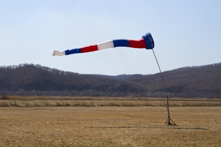 wind indicator on the airfield photo