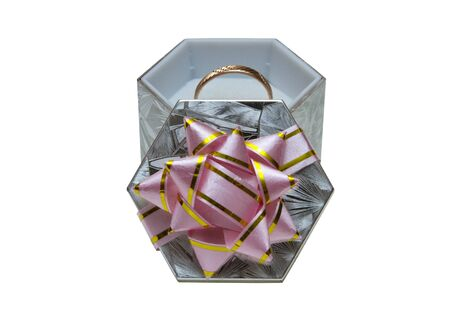 gift box with a gold ring on a white background photo