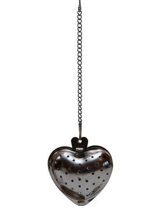 tea strainer in the shape of a heart on a chain photo