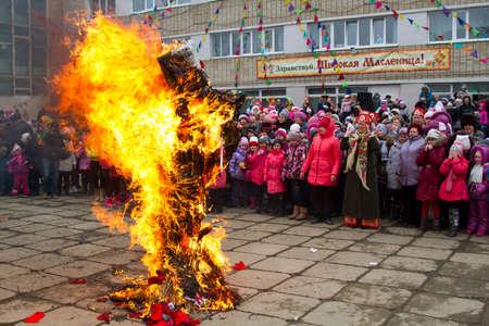 maslenitsa: BOLSOI KAMEN, RUSSIA, - MARCH 17, 2013: The celebration of the holiday of Maslenitsa, Bolsoi Kamen, Russia, March 17, 2013. The programm - burning effigy of winter.
