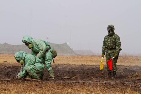 BOLSOI KAMEN, RUSSIA, - APRIL 3, 2013: Military exercises on emergency response in case of accidents at radiation-hazardous objects, Bolsoi Kamen, Russia, April 3, 2013. The contaminated area.