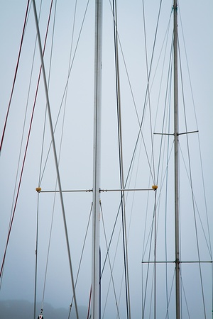 mast yacht without sails against the sky photo