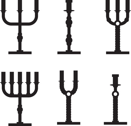 set of silhouettes of candlesticks