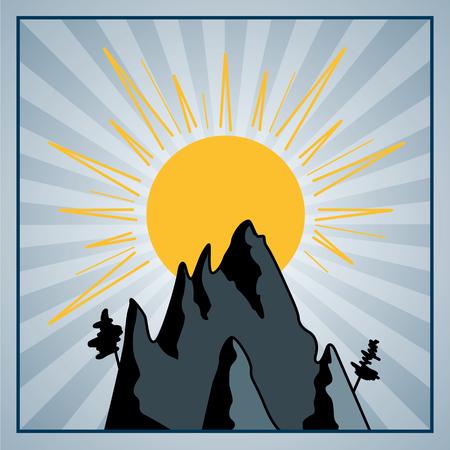 Rays of sun behind mountain