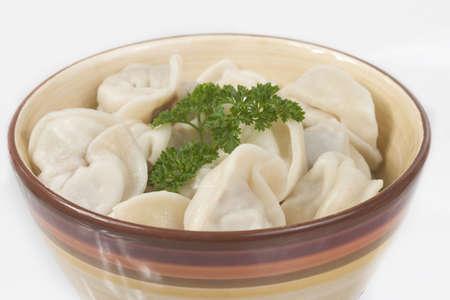 Russian hot pelmeni in a dish, close up Stock Photo
