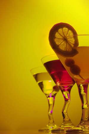 Three Martini glasses on colored background