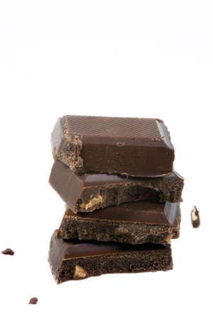 Black chocolate bar slices over white background Stock Photo