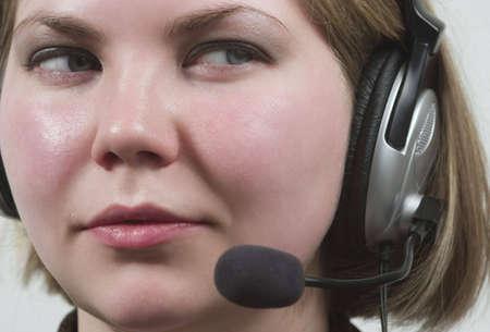 Girl in headphones with speakerphone communicating