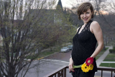 pregnant woman with a flower Stock Photo