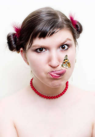 Portrait of a lady with red beads catching butterfly Stock Photo