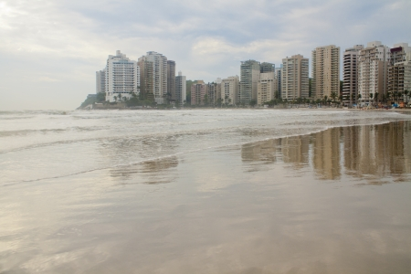 Sunrise Beach in Guaruja in sao paulo, Brazil, a coastal city dot the country  Fine effects of light into the water over water and clouds