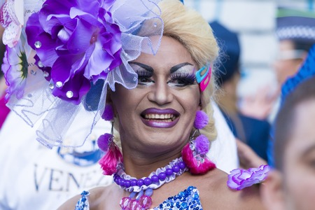 SAO PAULO, BRAZIL - June 7, 2015: An unidentified Drag Queen dressed in a costume celebrating lesbian, gay, bisexual, and transgender culture in the 19th Gay Pride Parade Sao Paulo Editorial
