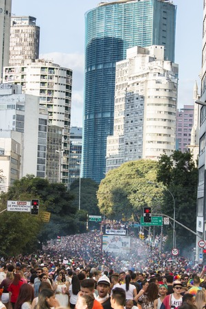 gay parade: SAO PAULO, BRAZIL - June 7, 2015: crowd at the gay parade, with building the center of the city in the background, in the 19th Gay Pride Parade Sao Paulo
