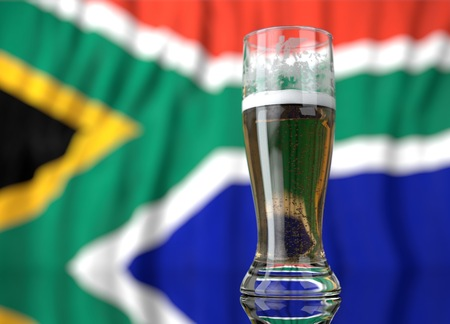 south african: 3d realistic illustration of a glass of beer in front of a blurred south african flag